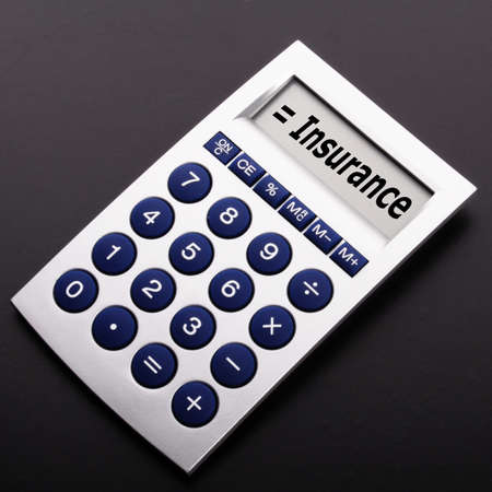 insurance or risk concept with calculator showing financial security Stock Photo - 9460501