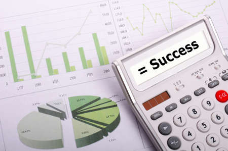 success concept with word on business calculator photo