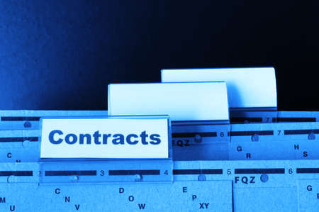 contract word on business folder showing trade or financial concept Stok Fotoğraf