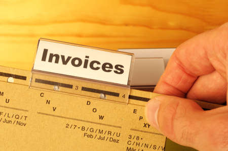 remit: invoice or invoices concept with business folder in office showing paperwork Stock Photo