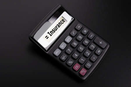 insurance or risk concept with calculator showing financial security Stock Photo - 9506039