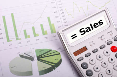sales growht concept with business calculator on office photo