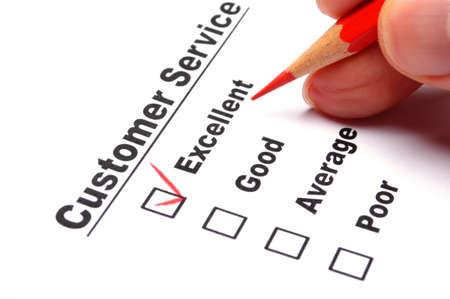 consommateurs: formulaire de sondage de qualit� avec le crayon rouge montrant le concept marketing Banque d'images