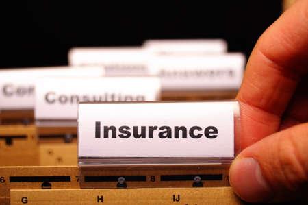 ビジネス フォルダー表示リスク管理の概念上の保険の単語 写真素材