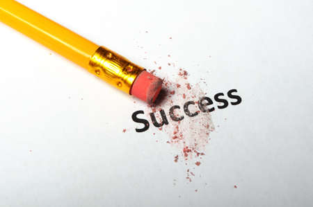 success or failure concept with word and eraser on white Stok Fotoğraf