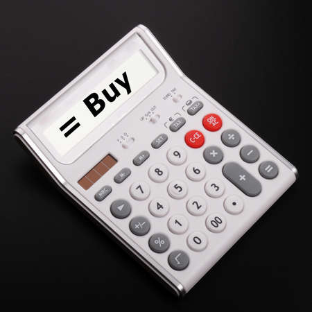 buy on calculator showing stock market or financial investment concept Stock Photo - 9594639