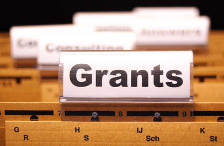 grants word on paper folder showing scholarship or higher education concept Stock Photo - 9594645
