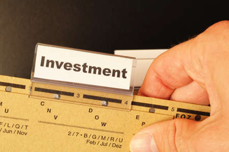 investment word on business folder showing financial success concept Stock Photo - 9594664