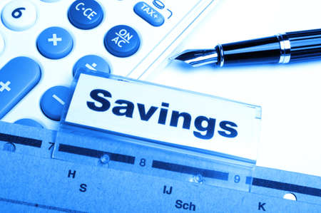 savings word on business folder showing saving money concept Stok Fotoğraf