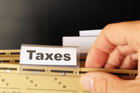 tax or taxes concept with word on business folder index Stock Photo - 9594647