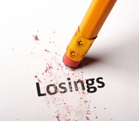 losing lose or luck concept with word and eraser on white background Stock Photo - 9594640