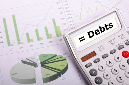 financial debt or credit concept with calculatur