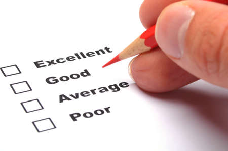 an opinion: checkbox and red pen showing customer service survey or satisfaction concept to improve sales