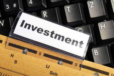 investment word on business folder showing financial success concept Stock Photo - 9771558