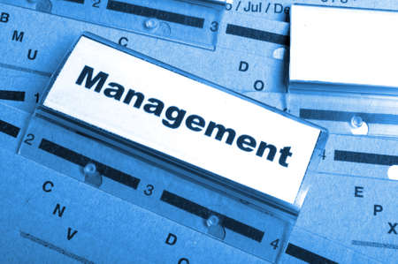 management word on business office folder showing leadership concept photo