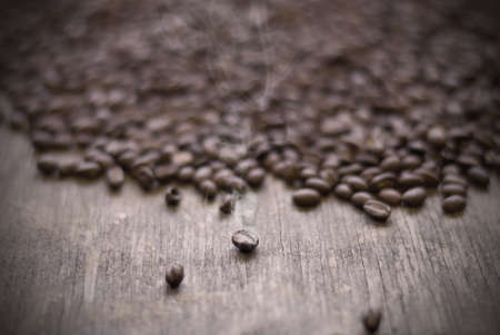 Roasted coffee beans on weathered wood