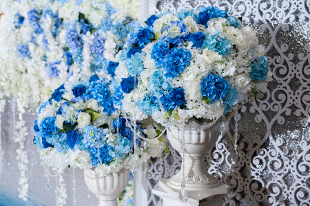 decorate: Blue flower on vases stand setting for Decorate with wedding backdrop for wedding party