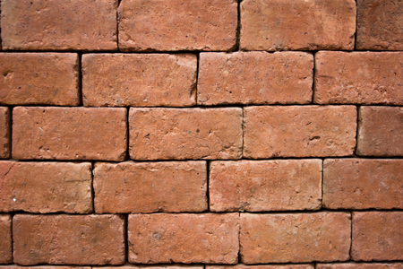 Red clay brick wall seamless background and texture pattern for continuous replicate Stock Photo
