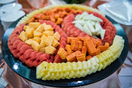 Slices of Asia fruit served on tray for buffet at hotel restaurant.