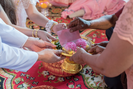 Thai Wedding Traditional. Bride and Groom have to pay respect their parents and they will send packet to newlywed  in wedding ceremony. Send pockets of money in tray. select focus