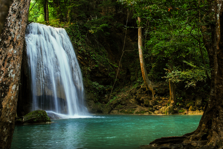 waterfall in the tropical forest where is in at Erawan National Park, Thailand Stock Photo