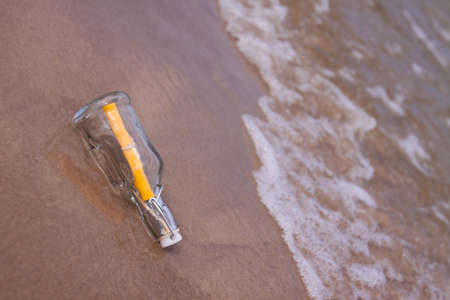Beach compositions. Botlle brought by the water photo