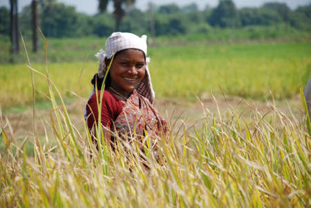 sweltering: Happy female farmer in the village