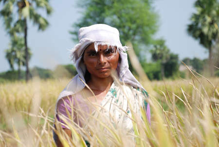 sweltering: Content female farmer of rural India