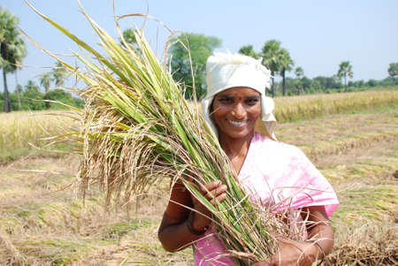 sweltering: Happy female farmer of rural India