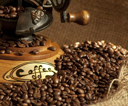 antique coffee grinder with beans photo