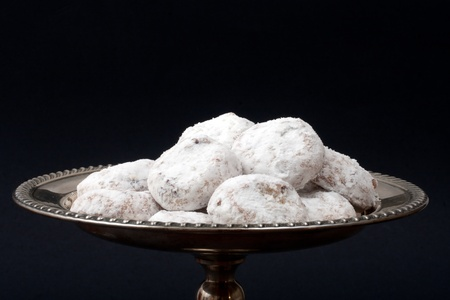 White Tea Cakes on a sterling silver tray on black background