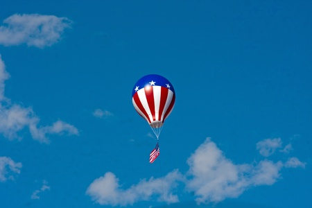 balloon against blue sky in red white and blue photo