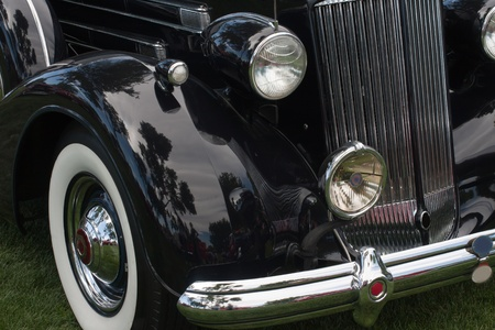 front of a classic car with headlight and fender photo