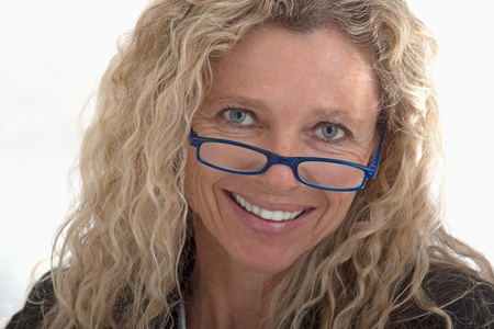 portrait of business woman headshot with blue glasses and bright smile Stock Photo - 9954314