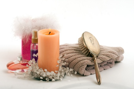 brush in: Candle perfume lotion towel hair brush in spa on isolated white Stock Photo