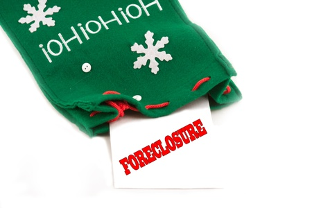 christmas debt: Foreclosure notice for the holidays in christmas sock