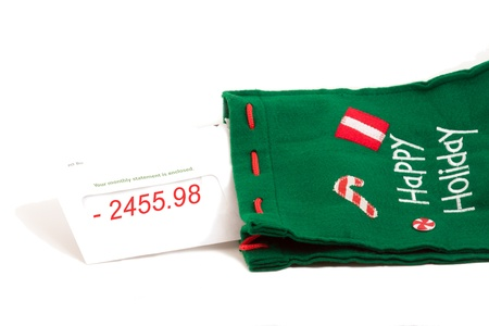 bank owned: bank statement notice for the holidays in christmas sock Stock Photo