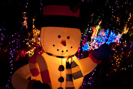illuminated inflatable snow man with x-mas lights Stock Photo - 11591076