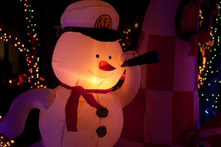 illuminated inflatable snow man with x-mas lights Stock Photo - 11591077
