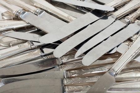 scrap trade: Silver scrap knives pile for melt