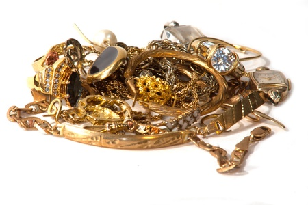 scrap gold: pile of old broken gold jewelry for scrap