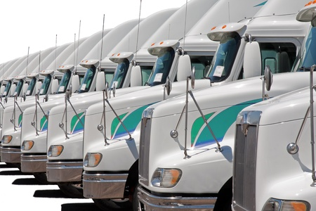 Semi truck fleet lined up in a row Stock Photo