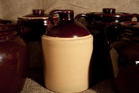 stoneware: Some stoneware pottery on a burlap background Stock Photo
