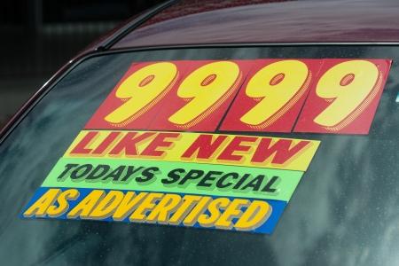 windshield sticker on a used car lot for sale Archivio Fotografico