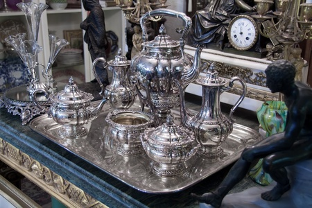 Vintage sterling silver Coffee Tea set displayed in antique store