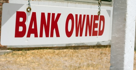 repossession: real estate pole for sale sign Bank Owned Stock Photo