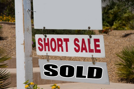 short sale: short sale and sold sign on pole with copy space