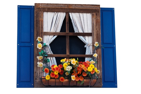 Country style window with flowers,planter, shutters and curtains, isolated photo