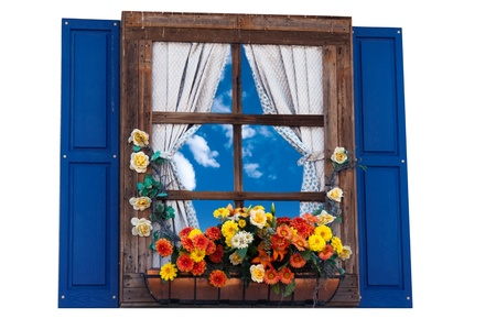 Country style window with flowers,planter, shutters and curtains,sky photo