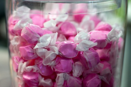 Pink wrapped Saltwater candy in glass container Banco de Imagens